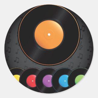 Turntablerekord i livliga färger runt klistermärke