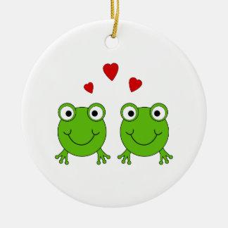 Två gröna grodor med röda hearts. julgransprydnad keramik