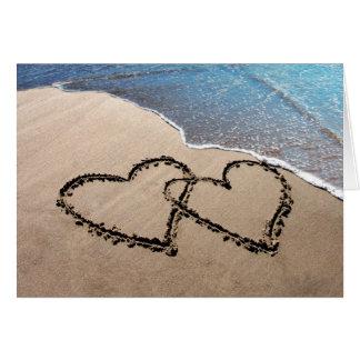 Två hjärtor i Sandhälsningkortet OBS Kort