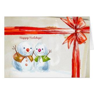 Två lyckliga snögubbear hälsningskort
