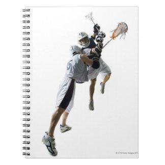 Två unga manar som leker lacrosse 2 anteckningsbok med spiral