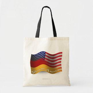 Tysk-Amerikan som vinkar flagga Tygkasse