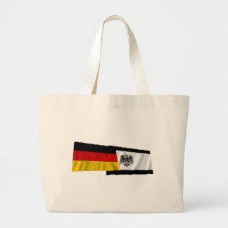 Tyskland & Preussen som vinkar flaggor Kassar