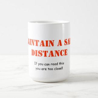 Underhåll en säker avståndsmugg kaffemugg
