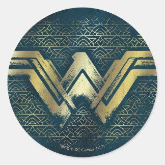 Undra kvinna borstat guld- symbol runt klistermärke