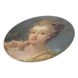 Ung kvinna med en bukett av ro tallrik
