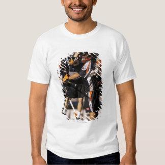UNIONDALE NY - JUNI 03:  Peet Poillon #57 och Tee Shirts