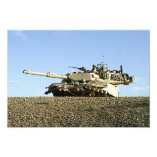 Us-flottor ger säkerhet i en M1A1 Abrams t Fotografier