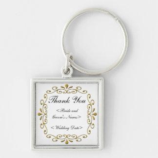 Utsmyckad guld- bröllopram fyrkantig silverfärgad nyckelring