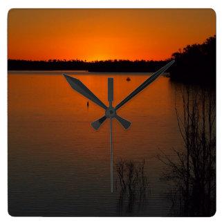 Väggen för den sjöMonduran solnedgången tar tid på Fyrkantig Klocka