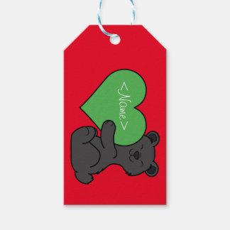Valentin gullig svart björn för dag med grön presentetikett