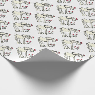 Valentinhäst som slår in papper presentpapper