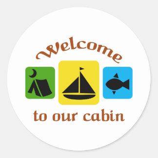 Välkomnande till vår kabin runt klistermärke