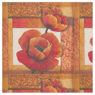 Vallmon blommar på solbränd och orange bakgrund tyg