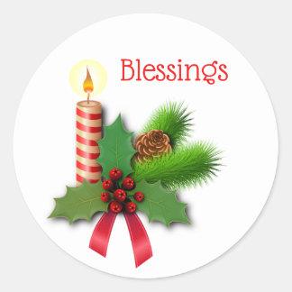Välsignelsejärnekstearinljus med det röda bandet runt klistermärke