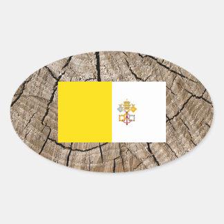 Vatican flagga på trädskäll ovalt klistermärke