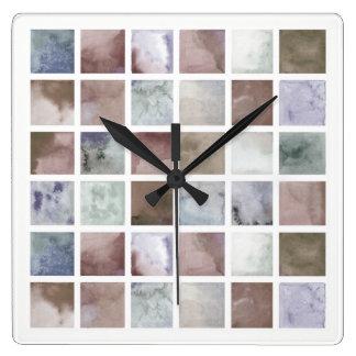 Vattenfärg. Beigen och grå färg kvadrerar. Fyrkantig Klocka