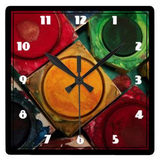 Vattenfärgen målar boxas paletten fyrkantig klocka