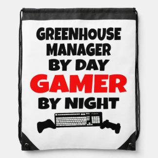 Växthuschef av daggameren vid natt backpack