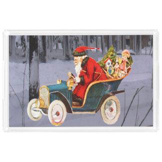 Vintage Santa som kör i ett modernt Bricka