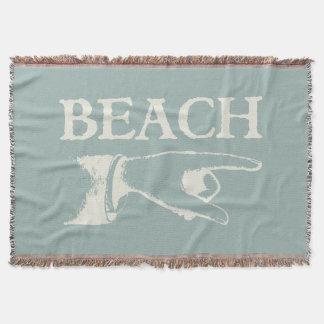 Vintage som pekar stranden, undertecknar mysfilt