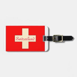 Vintage tittar märkre för schweizareflaggabagage bagagebricka