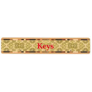 Vintage utföra i relief metalliskt guld nyckelhängare