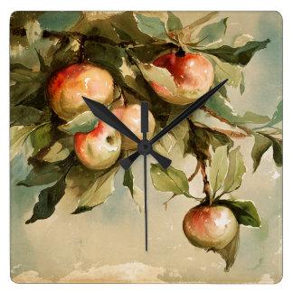 Vintageäpplen på en gren fyrkantig klocka