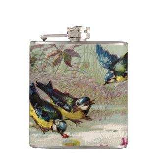 Vintagefåglar i slågna in flaskan för snö den fickplunta