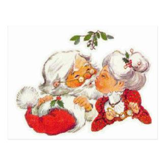 Vintagejul Santa som kysser Fru Claus Vykort