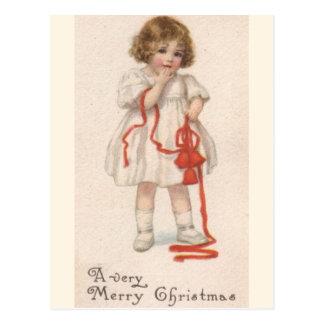 Vintageliten flicka med julbandet vykort