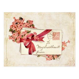 Vintagevalentinkärlek märker och blommar vykort