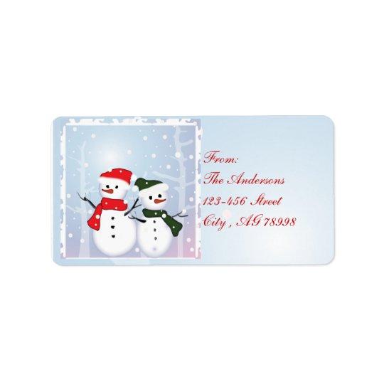 Vinterunderlandsnögubbe vår första jul adressetikett