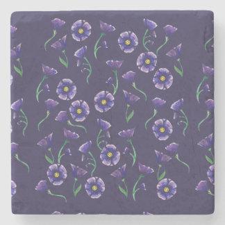 Violett lilablomma stenunderlägg