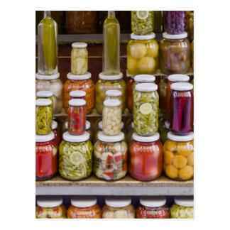 Visning av inlagda frukter och vegetables. vykort