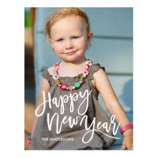 Vit borstar skrivar överdrar gott nytt årfotoet vykort