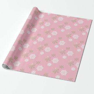vit- och guldsnöflingor mot bleken - rosa presentpapper