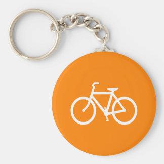 Vit och orange cykel rund nyckelring