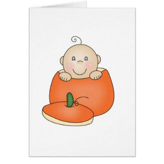 Vitbaby i pumpa hälsningskort