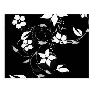 Vitblommigt på svart vykort