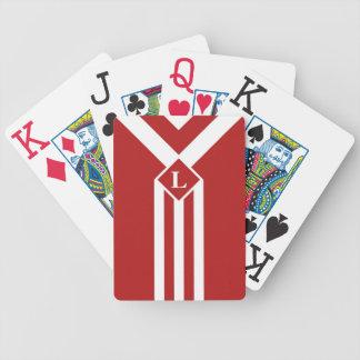 Vitrandar och sparrar på rött med monogramen spelkort