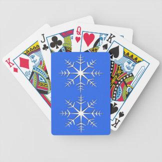 Vitsnöflingor på blått spelkort