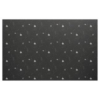 Vitstjärnor på svart tyg