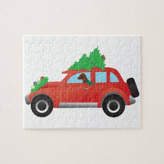Vizsla jakthund som kör en julbil pussel