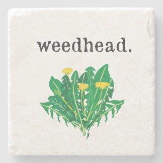 weedhead. (maskros) underlägg sten