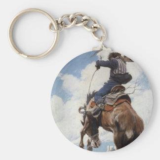 Westerna Cowboys för vintage som sparkar bakut vid Rund Nyckelring