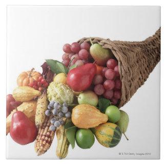 Ymnighetshorn av frukt och grönsaker kakelplatta